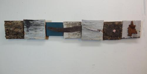 segmented long peice with found objects and water painting