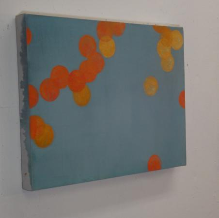 small abstract of orange bubbles on blue background
